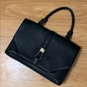 Black purse with gold details